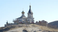 4K video with Christian Orthodox Church on a hill in Old Orhei, Moldova Stock Footage