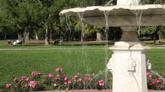 Fountain in the park and a child on a bicycle 2 Stock Footage