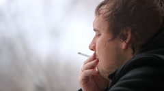 Man smoking cigarette and looking in the window. It snows. HD. 1920x1080 Stock Footage