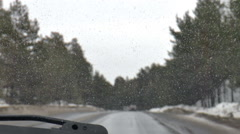 Winter road. Dirty windshield Stock Footage