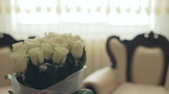 White room interior, window, white roses, pillows Stock Footage