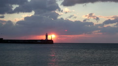 Sunrise over a beacon, a view from central embankment of Yalta, the Crimea Stock Footage