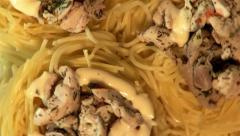 3 spaghetti nests with chicken pieces on plate, top shot, close-up Stock Footage
