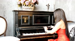 Stock Video Footage of Beautiful young attractive woman in evening dress with piano