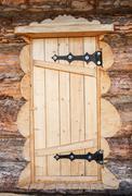 wooden door of log house - stock photo