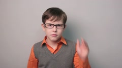 Teenager boy migraine headache holding his head ten years in glasses Stock Footage