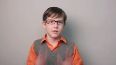 Boy teenager surprise a happiness joy waves his hands for ten years in glasses Stock Footage