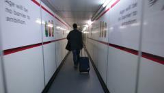 Airport Passenger Walkway walking to Plane Stock Footage