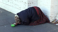 Pauper woman begging on the street of Rome Stock Footage