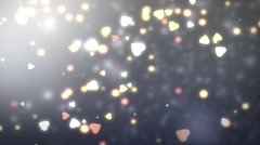 Color background with hearts and bokeh elements on it - seamless loop. Stock Footage
