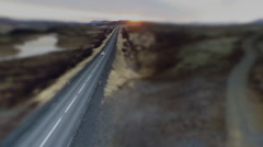 Tilt-shift of car on country road during sunset Stock Footage