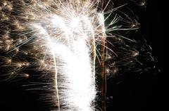 Large brightly shining fireworks at new year party Stock Photos