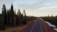High angle shot of cars driving on road through forest Stock Footage