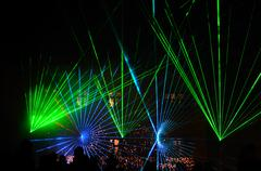 Bright green blue laser show at night with audience Stock Photos