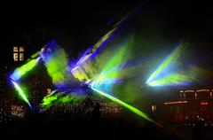 colorful laser show with blue green forms - stock photo