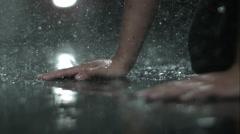 Hand movement in rain Stock Footage