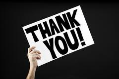 Man holding poster with thank you Stock Photos