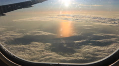 Airplane Window View, Above Clouds, Flying - stock footage