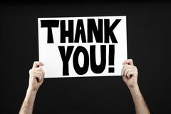Man holding poster with thank you - stock photo
