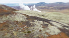 Steam rising from natural geothermal hot spring area, Iceland Stock Footage