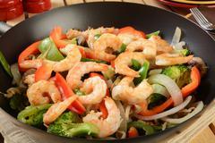 Shrimp stir fry in a wok Stock Photos
