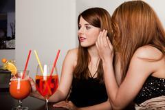 Girls talking gossips - stock photo
