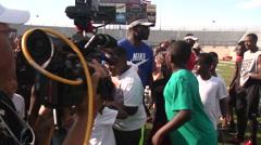 Michael Vick at youth football camp, 1080p HD Stock Footage