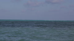An unidentified windsurfer sails in Belize - stock footage