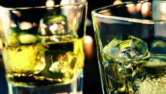 Barman pouring whiskey on bar table and take these, whisky relax time Stock Footage