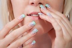 Women with acrylic fingernails Stock Photos