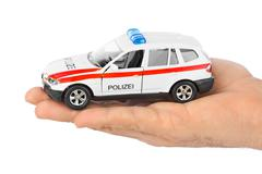 Hand with toy police car Kuvituskuvat