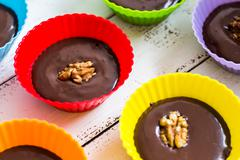 Chocolate Truffles in Colorful Cups Stock Photos