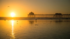 Sunset timelapse at the Huntington Beach Pier in Huntington Beach, California Stock Footage