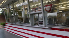 Pan of the original red and white tiled McDonald's restaurant Stock Footage