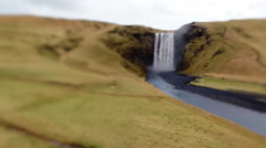 Tourists at the Skogafoss waterfall in Iceland - stock footage