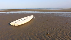Small boat on the shore, low tide 1080p HD Stock Footage