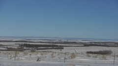 Snow flat desert view from driving vehicle on the road Stock Footage
