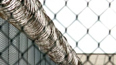 Prison Razor Wire Fence Rack Focus 30fps - stock footage