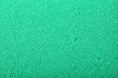 Green texture cellulose foam sponge background - stock photo