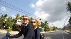 Happy Couple on Scooter Enjoying Trip at Summer. Slow Motion Stock Footage