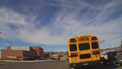 School Buses Approaching High School In Small Town - stock footage