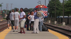 A Metra train arrives at a train station, 1080p HD Stock Footage