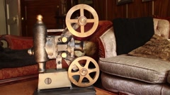 VINTAGE MOVIE PROJECTOR (DOLLY MOVE) Antique Furniture in Background (#2) Stock Footage