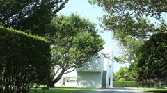 Exterior entrance to a modern white house in East Hampton, NY - stock footage