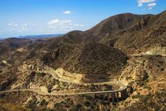Andalusia, landscape. Road in Cabo de Gata Park, Almeria. Spain Stock Photos