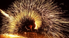 Amazing Fire Show in a Circular Motion at Night on Beach. Party Time - stock footage