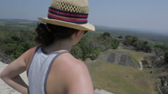 Young woman atop the Xunantunich temple in Belize Stock Footage