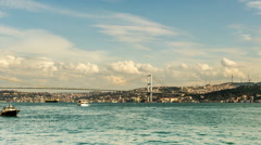 Time Lapse Photography clouds moving across the blue sky with Bosphorus Bridge Stock Footage