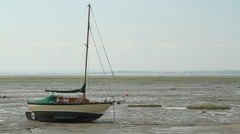 A sailboat at low tide on Leigh-on-Sea, Essex, United Kingdom Stock Footage