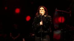 Frozen's Idina Menzel sings 'Silent Night' Stock Footage